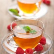 Tea with mint and raspberry - Stock Photo