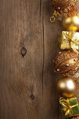 Christmas background with golden decoration — Stock Photo