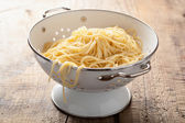Spaghetti in colander — Stock Photo
