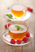 Tea with mint and raspberry — Stock Photo