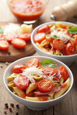 Pasta with tomatoes and salami — Stock Photo