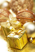 Golden christmas gifts and decoration — Stock Photo