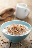 Buckwheat groats with milk — Stock Photo
