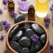 Spa stones salt and lavender oil — Stock Photo