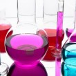 Laboratory glassware with colorful chemicals — Stok Fotoğraf #19483195
