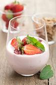 Strawberry yogurt with cornflakes and mint — Stock Photo