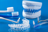 Individual tooth tray for whitening and toothbrushes — Stock Photo