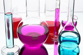 Laboratory glassware with colorful chemicals — Stock Photo