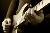 Guitarist hands — Stock Photo