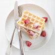 Royalty-Free Stock Photo: Waffle with raspberry and icing sugar