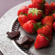 Royalty-Free Stock Photo: Strawberry and chocolate on vintage plate