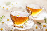 Cup of herbal tea with chamomile flowers — Foto Stock