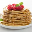 Pancakes with honey and raspberry — Stock Photo #27040245