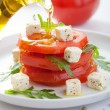 Stock Photo: Pouring olive oil over salad with beef tomatoes and feta