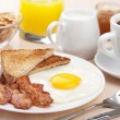 Stock Photo: Traditional breakfast with fried egg and bacon