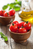 Cherry tomatoes and basil — Stock Photo