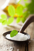 Salt in wooden spoon for spa — Stock Photo