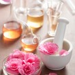 Aromatherapy and alchemy with pink flowers — Stock Photo