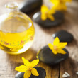 Spa stones essential oil and yellow flowers for spa — Stock Photo