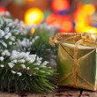 Christmas gifts and decoration over blurred background — Stock Photo