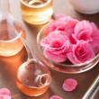 Aromatherapy and alchemy with pink flowers — Stock Photo #32799551