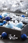 Black box full of christmas decoration — Stock Photo