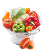 Colorful vegetables in colander isolated — Stock Photo