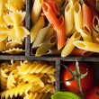 Various pasta in black wooden box — Stock Photo #33320757