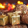 Golden christmas gifts and decoration — Stock Photo #33320835