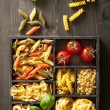 Various pasta in black wooden box — Stock Photo #33626215