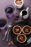 Tartelettes with chocolate ganache and walnuts — Stock Photo