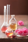 Aromatherapy and alchemy with pink flowers — Stock fotografie