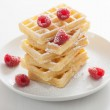 Waffles with raspberry and icing sugar — Stock Photo