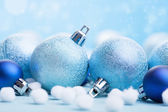 Blue christmas balls over blurred background — Stock Photo