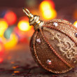 Stock Photo: Golden christmas ball over blurred colorful background