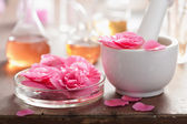 Alchemy and aromatherapy with pink flowers — Stock Photo