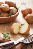 Baked potato with rosemary — Stock Photo