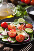 Salad with tomatoes cucumber and goat cheese — Stock Photo