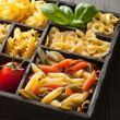 Various pasta in black wooden box — Stock Photo #38766365