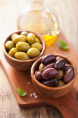 Black and green marinated olives in bowl — Stock Photo
