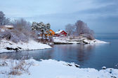 Norwegian winter fjord landscape with colorful houses — Stock Photo