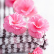 Pink flowers and towel for spa — Stock Photo