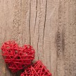 Red hearts over wooden background for Valentines day — Stock Photo #40135141