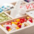 Stock Photo: Medical pills and ampules in wooden box