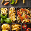 Various pasta in black wooden box — Stock Photo #40524821