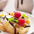Belgian waffles with chocolate and raspberry for breakfast — Stock Photo