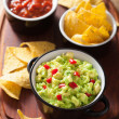Guacamole with avocado, lime, chili and tortilla chips, salsa — Stock Photo #41211439