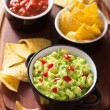 Guacamole with avocado, lime, chili and tortilla chips, salsa — Stock Photo