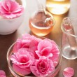 Aromatherapy and alchemy with pink flowers — Stock Photo #41211547