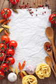 Blank paper for recipes with ingredients tomatoes pasta pepper  — Stock Photo